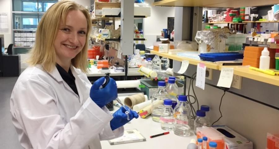 Photo of Dr. Leigh Waddell working at the INMR lab